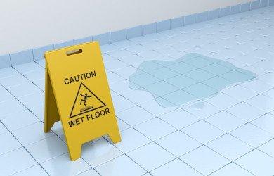 wet floor caution sign on tiled floor
