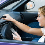 texting on cell phone while driving car