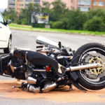 motorcycle tipped sideways after crash