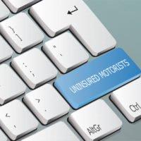 uninsured motorists written on the keyboard button