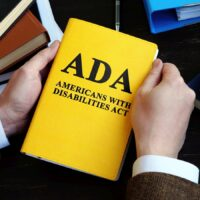 Americans with Disabilities Act ADA law on the wooden surface.